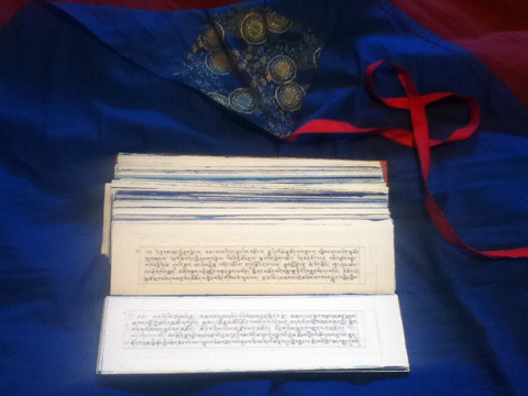 Unwrapped Tibetan Scripture.