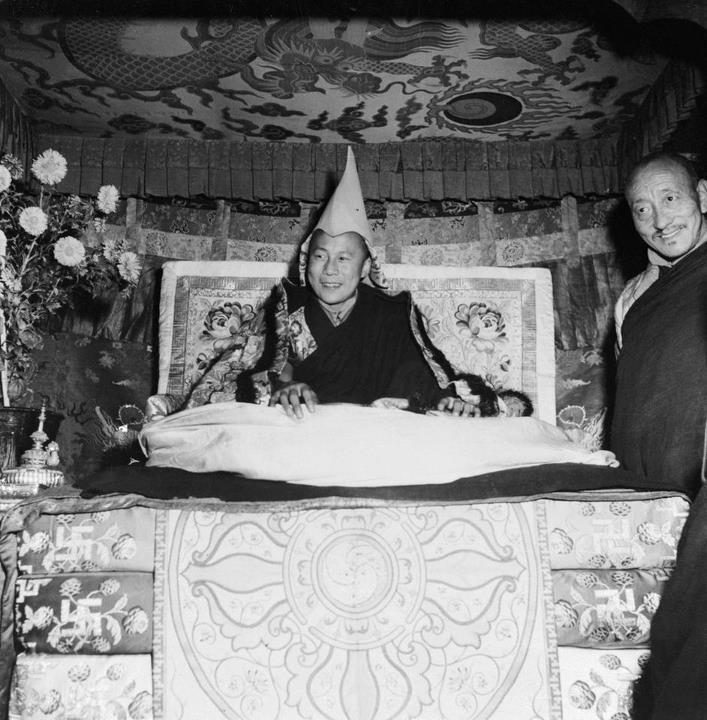 HH 16 Dalai Lama B&W on throne in Tibet