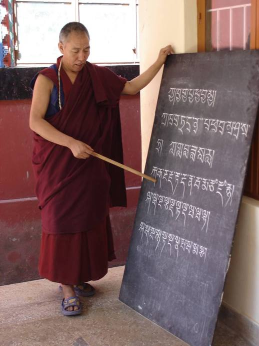 Bon lama teaching Tib language from The Gatekeeper book