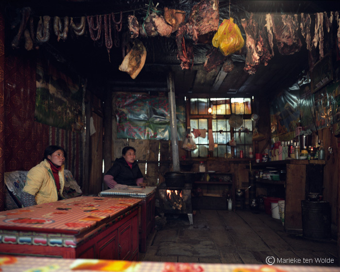 Tibetan household in kham with photo credit