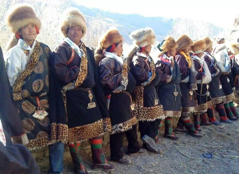 Men of Dolpo, Nepal in traditional dress during a festival