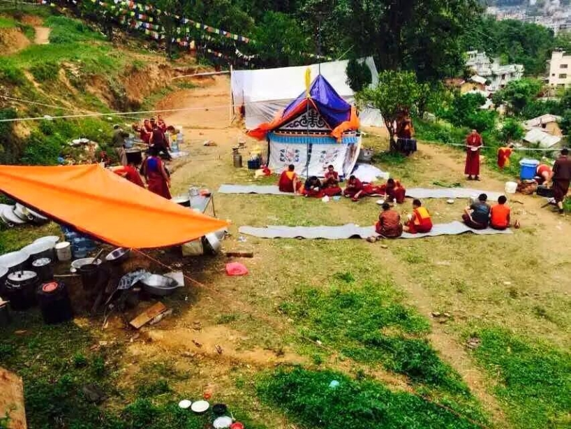 Triten monks staying outside after earthquake 2